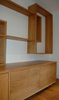 Oak statement storage unit with shelves and drawers